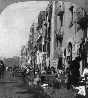 ITALY: NAPLES, c1904. An impovished street in Naples, Italy. Stereograph, c1904.