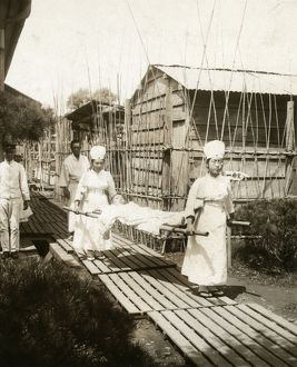JAPAN: NURSES, c1905. Japanese nurses carrying a patient on a stretcher. Photograph