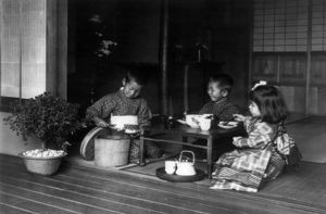 JAPAN: TEA PARTY. Three children having a tea party around a table in Japan. Photograph