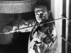JASCHA HEIFETZ (1901-1987). American (Russian-born) violinist. Playing in his New York apartment