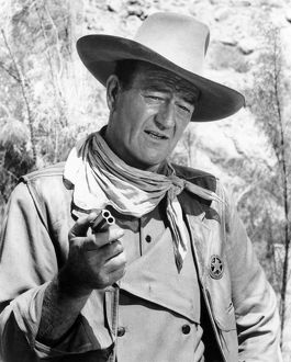 JOHN WAYNE (1907-1979). American actor. Wayne in a scene from 'The Comancheros'.