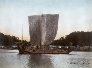 JUNK SHIP, c1900. A junk ship in Japan. Hand colored photograph, c1900