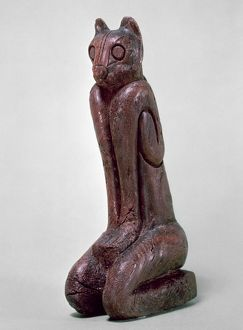 KEY DWELLERS: CAT FIGURE. Seated cat figure, carved wood sculpture from the Key Dweller