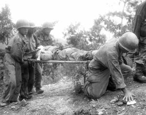 KOREAN WAR, 1952. Western Front: Battle-weary allied soldiers carry their wounded