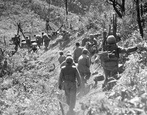 KOREAN WAR: TRIANGLE HILL. After enemy artillery has disrupted the Allied trolley system