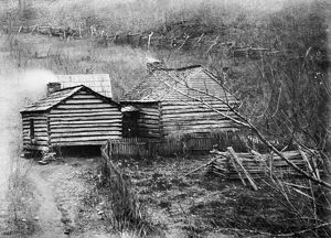 LOG CABIN, c1909. The home of a moonshine maker in rural America. Photograph, c1909