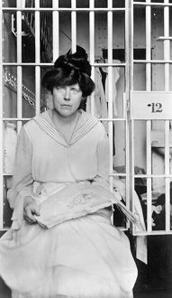 LUCY BURNS (1879-1966). American suffragist and women's rights advocate. Photographed in jail