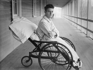 MAN, c1915. A man sitting in a wheelchair, possibly at an open air sanitorium. Photograph