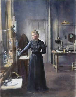 MARIE CURIE (1867-1934) in her laboratory at the Sorbonne, Paris: oil over a photograph