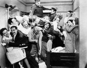 THE MARX BROTHERS, 1935. Some of the ship's crew join the Marx Brothers in their