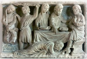 Mary Magdalene washes Jesus' feet with her hair. Stone relief, Burgundy, France