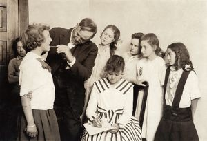 MEDICAL EXAM, 1917. School children receiving throat exams at Washington School in Lawton