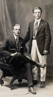 MEN'S FASHION, 1917. American studio portrait of two brothers, 1917