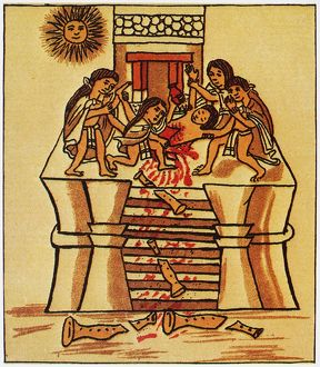 MEXICO: AZTEC SACRIFICE. Priests cutting out the heart of a youth to sacrifice to the sun