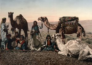 MIDDLE EAST: TRAVELERS. A group of travelers and their camels resting in the desert