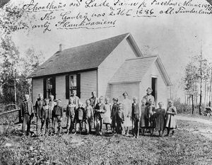 MINNESOTA: SCHOOL, c1895. Children, probably of German immigrant settlers, in front