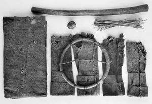 Moccasin game kit, with wooden hoop, stick, ball, and stack of twigs. Chiricahua Apache