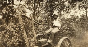 MOWING ACCIDENT, 1915. A twelve-year old boy driving the mowing machine which cut