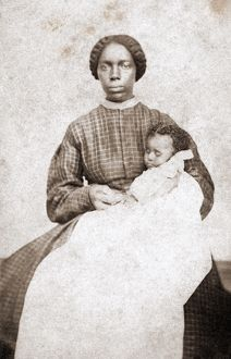 NANNY & CHILD, c1865. Photograph, c1865
