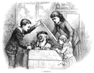 NAST: CHRISTMAS, 1885. 'A Christmas box.' Engraving by Thomas Nast, 1885