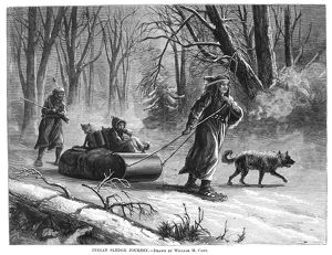 NATIVE AMERICANS: SLED, 1875. A Native American family traveling by sled and snowshoe