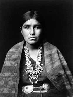 NAVAJO WOMAN, c1904. Navajo woman wearing a silver squash blossom necklace, concho belt