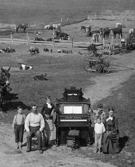 NEBRASKA: FRONTIER FAMILY. The family of David Hilton posing next to their organ