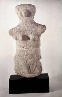 NEOLITHIC FIGURE. Neolithic grey limestone female figure from Karpathos, Dodecanese Islands