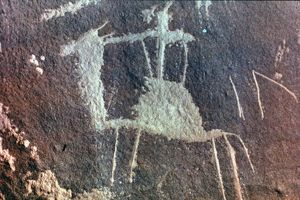 NEOLITHIC PETROGLYPH of a man on a dromedary from Sinai, Israel.