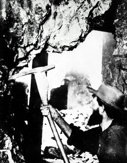 NEVADA: MINING, 1867. A miner at work underground in Virginia City, Nevada
