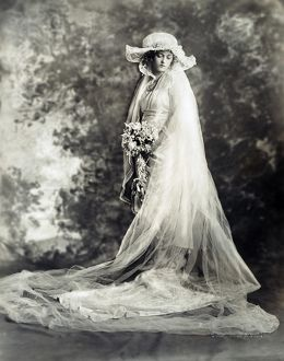 NEW YORK: BRIDE, 1920. Marion Davies photographed in her wedding gown, New York City