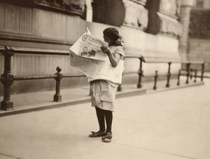 NEW YORK: NEWSGIRL, 1910. A newsgirl on Park Row in New York City