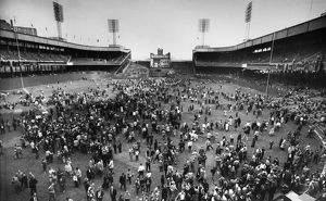 NEW YORK: POLO GROUNDS. Crowd of baseball fans pouring onto the field at the Polo