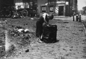 us cities/new york poverty 1915 barefoot boy picking