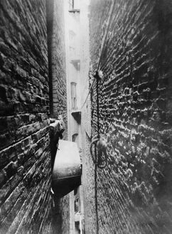NEW YORK: TENEMENT, c1890. Bathtub stored in a tenement air shaft. Photograph by Jacob A