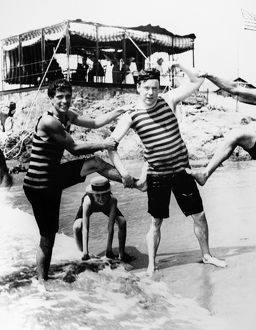 NEWPORT: BATHERS, c1895. William Kissim Vanderbilt II (left), Harry Lehr, and young