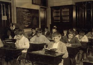 NIGHT SCHOOL, 1909. Working immigrant boys in a evening class for all nationalites