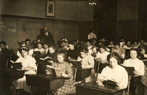 NIGHT SCHOOL, 1909. Working immigrant girls in an evening class for all nationalities