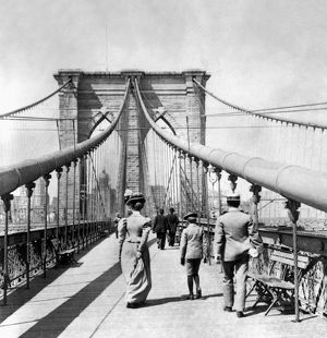 NY: BROOKLYN BRIDGE, 1899. On the pedestrian promenade of the Brooklyn Bridge. Photograph