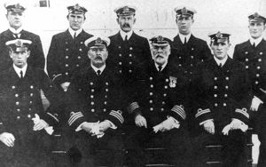 OFFICERS OF THE TITANIC, 1912. Standing, left-to-right: Herbert McElroy, Chief Purser
