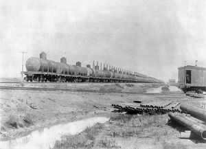 Oil tank cars on a railroad near Spindletop oil field in Texas, c1901.