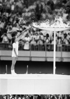 OLYMPIC GAMES, 1976. Torch bearers Sandra Henderson and Stephane Prefontaine lighting