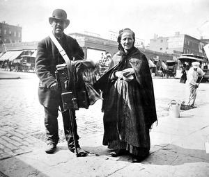 ORGAN GRINDER, 1897. An organ-grinder and his wife in New York City, 1897.