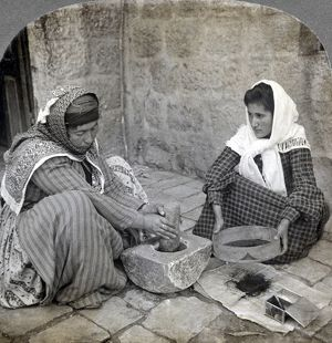 PALESTINE: GRINDING COFFEE. Two Palestinian women grinding coffee. Stereograph, c1905