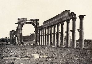 PALMYRA: TRIUMPHAL ARCH. Ruins of a colonnade and a triumphal arch at Palmyra, Syria