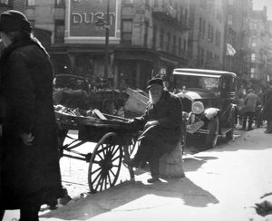PEDDLER, c1915. A pushcart peddler, c1915, in an unidentified American city