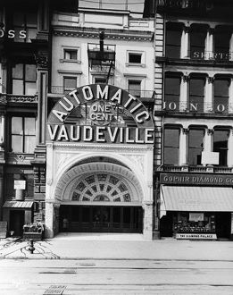 PEEP SHOW THEATER, 1890s. The Automatic One Cent Vaudeville, a peep show arcade