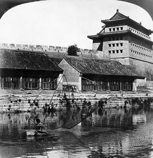 PEKING: FISHERMEN, 1907. Fishermen in the Grand Canal near the East Gate of the
