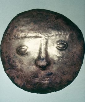 PERU: CHIMU BRONZE DISC. Hammered bronze disc with a human face in relief, made by