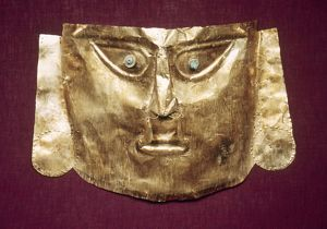 PERU: CHIMU GOLD MASK. Gold mummy mask made by the Chimu culture of ancient Peru